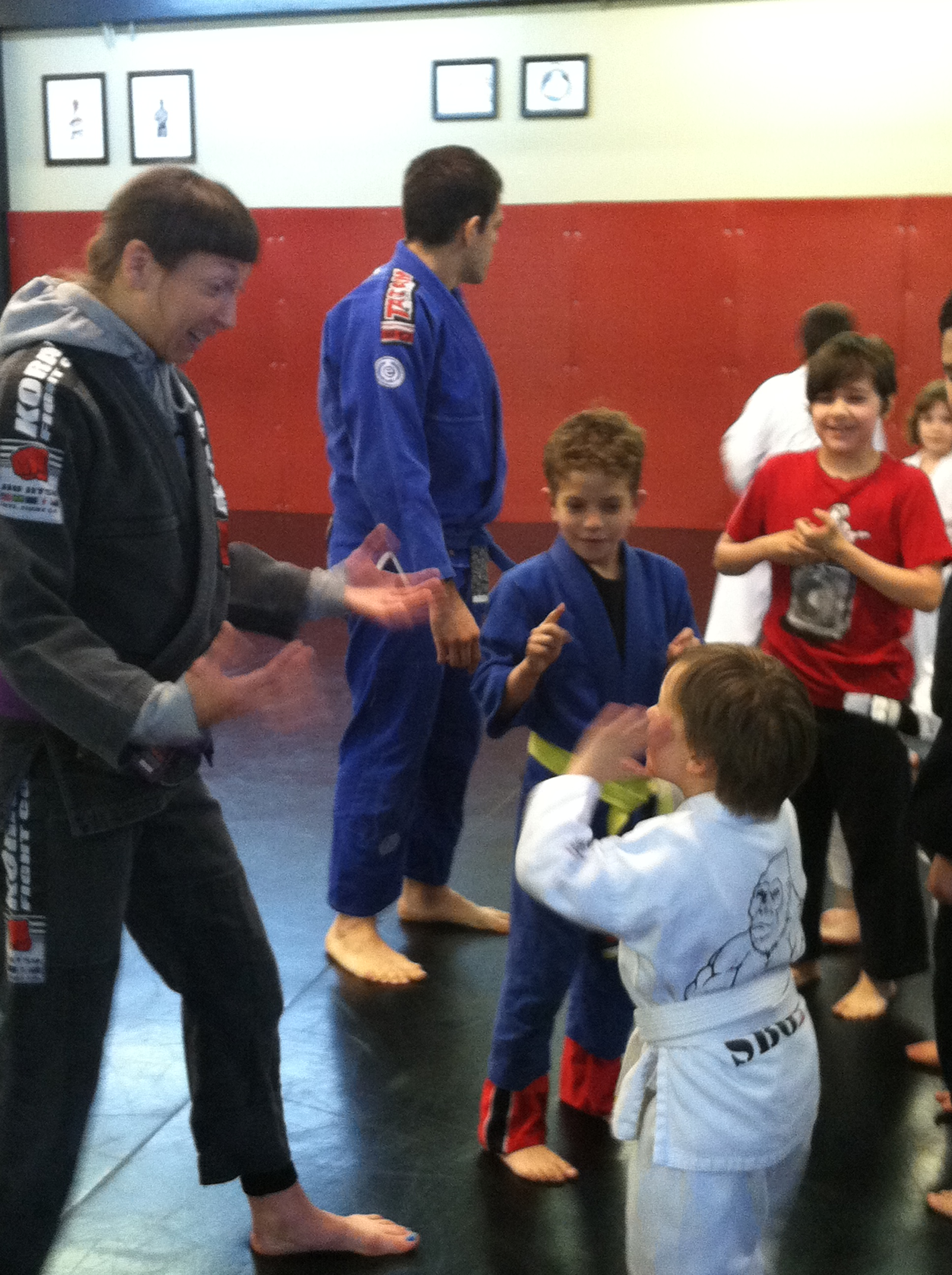 Coaches having fun with the kids in martial arts class.