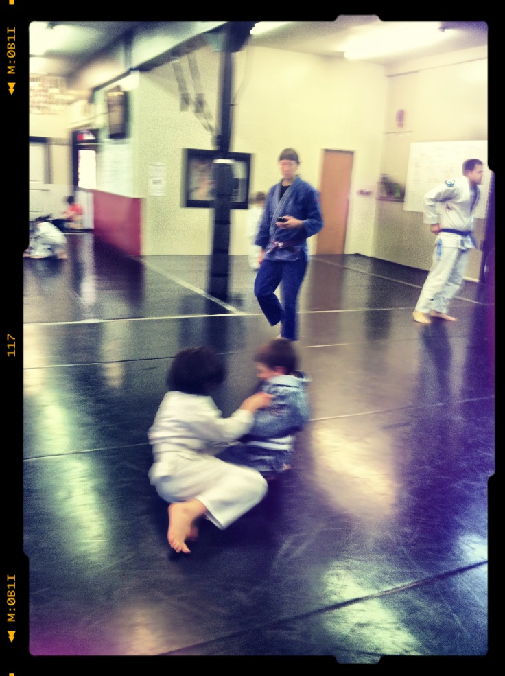 Live drills while coach Amanda looks on in kids martial arts class.