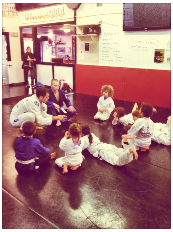 Kids martial arts class, a small group collaborates