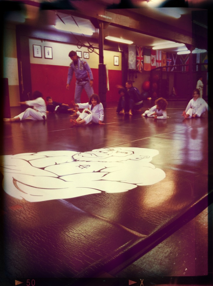 Warm ups in kids martial arts class.