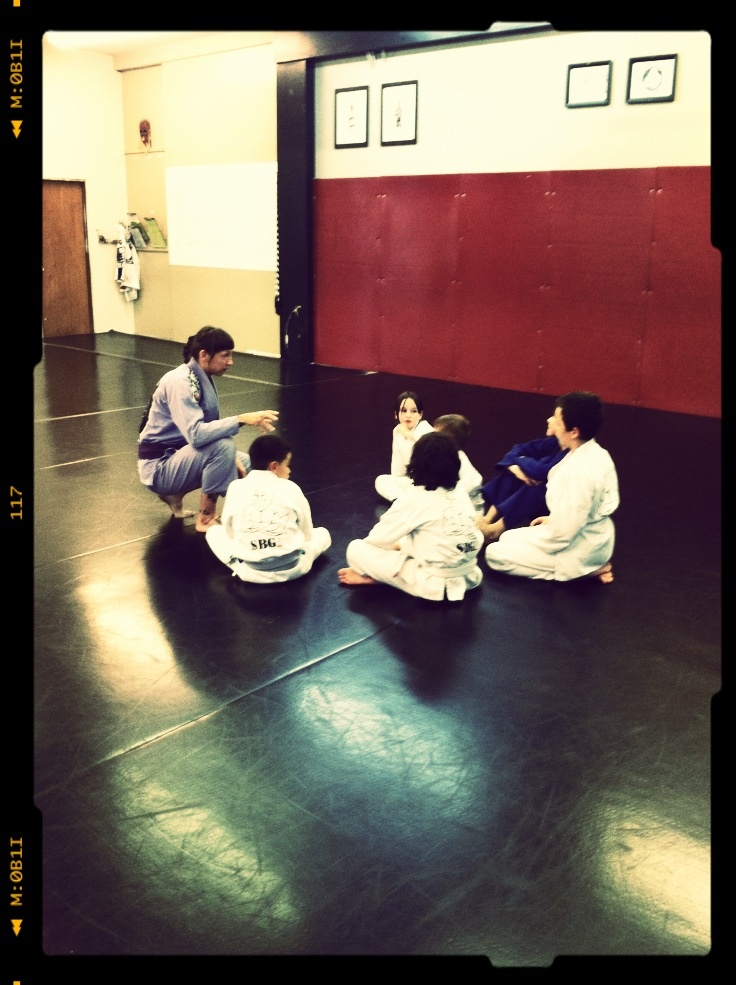 Coach Amanda with a small group in her kids martial arts class