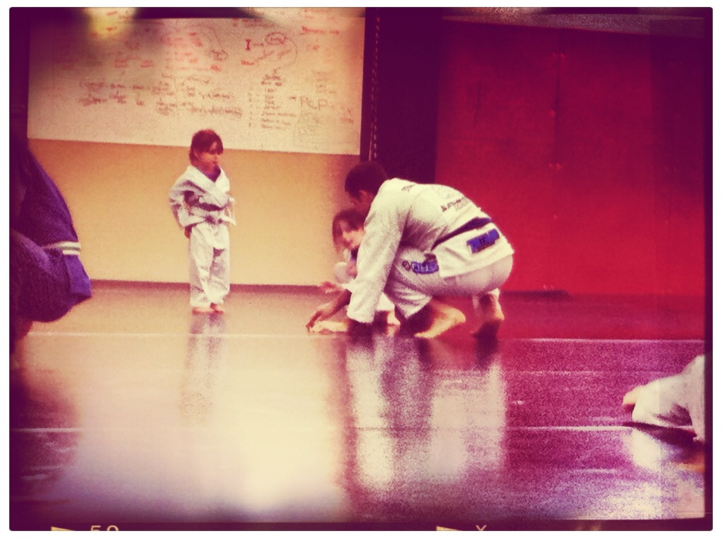 Coaching the kid's martial arts class