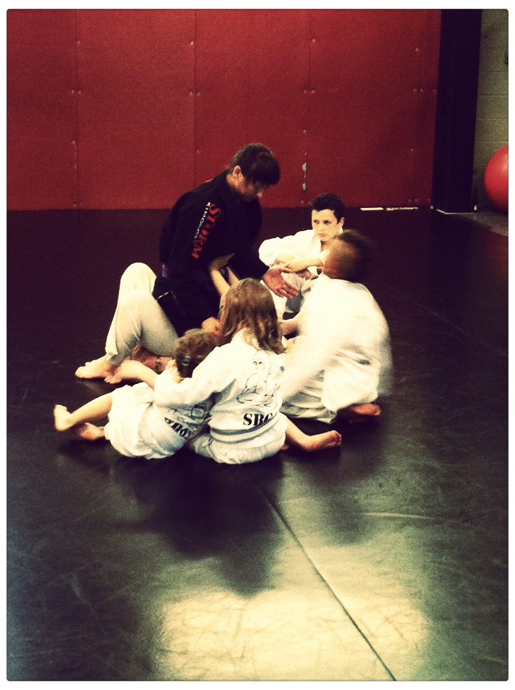 Coaching a small group in kid's martial arts class