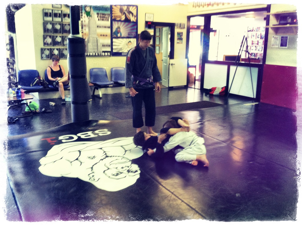 Coach Amanda coaching the matches in kid's martial arts class
