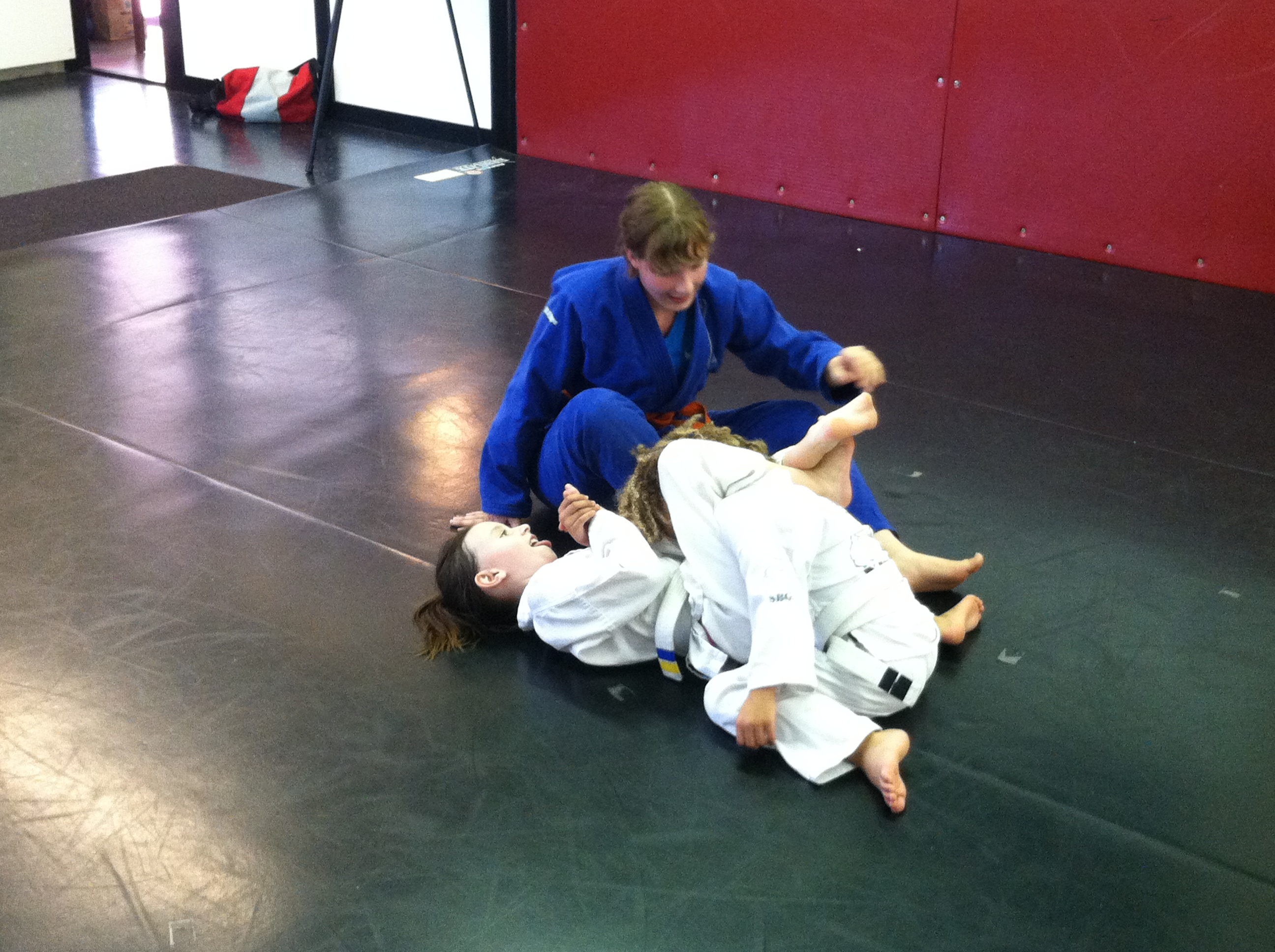 Coaching a triangle in kid's martial arts class.