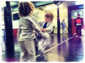 Drilling with a resisting partner in kid's martial arts class