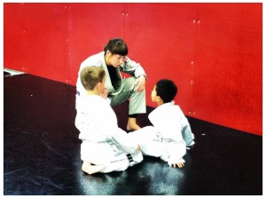 Giving instruction in kid's martial arts class