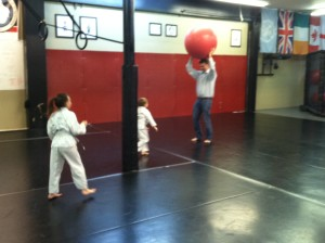 Dad plays before kid's martial arts class
